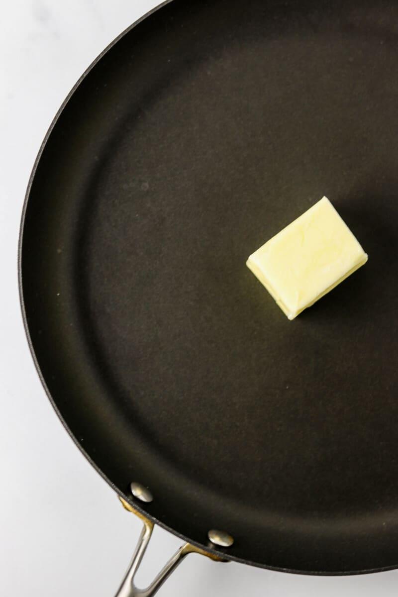 Butter in black pan.