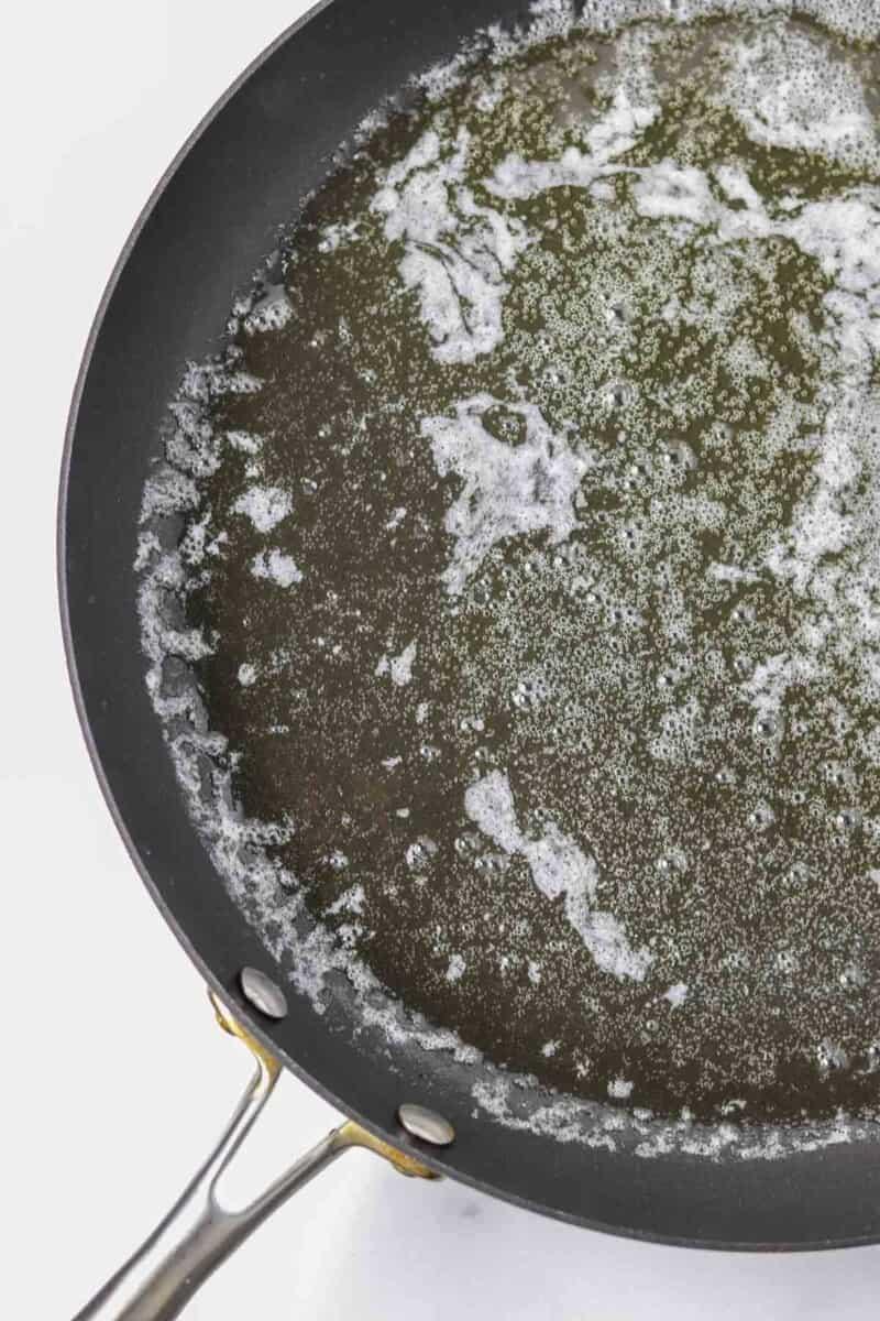 Melted butter in a black skillet.