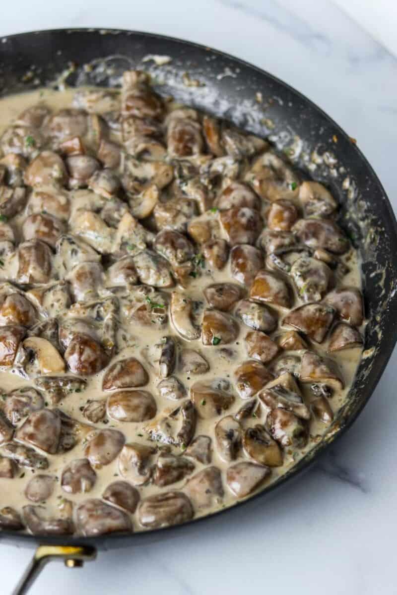 Creamy mushrooms in a skillet.