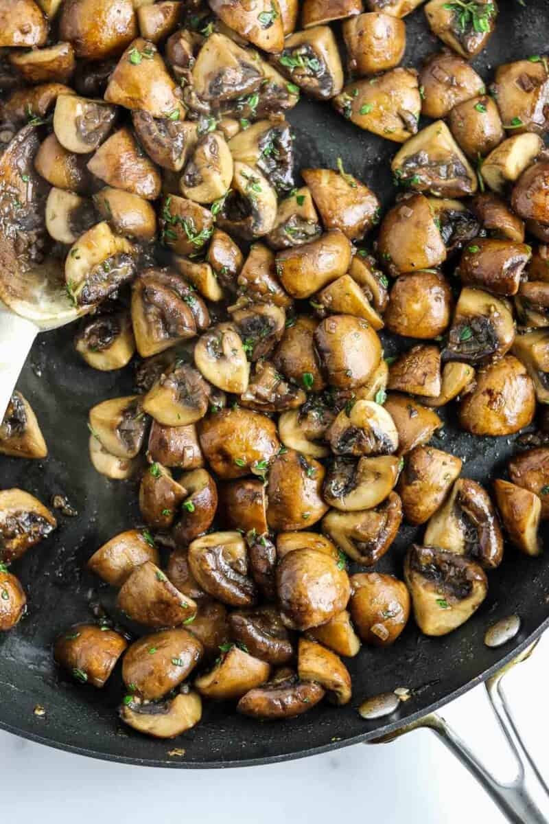 Cooked mushrooms in a skillet.