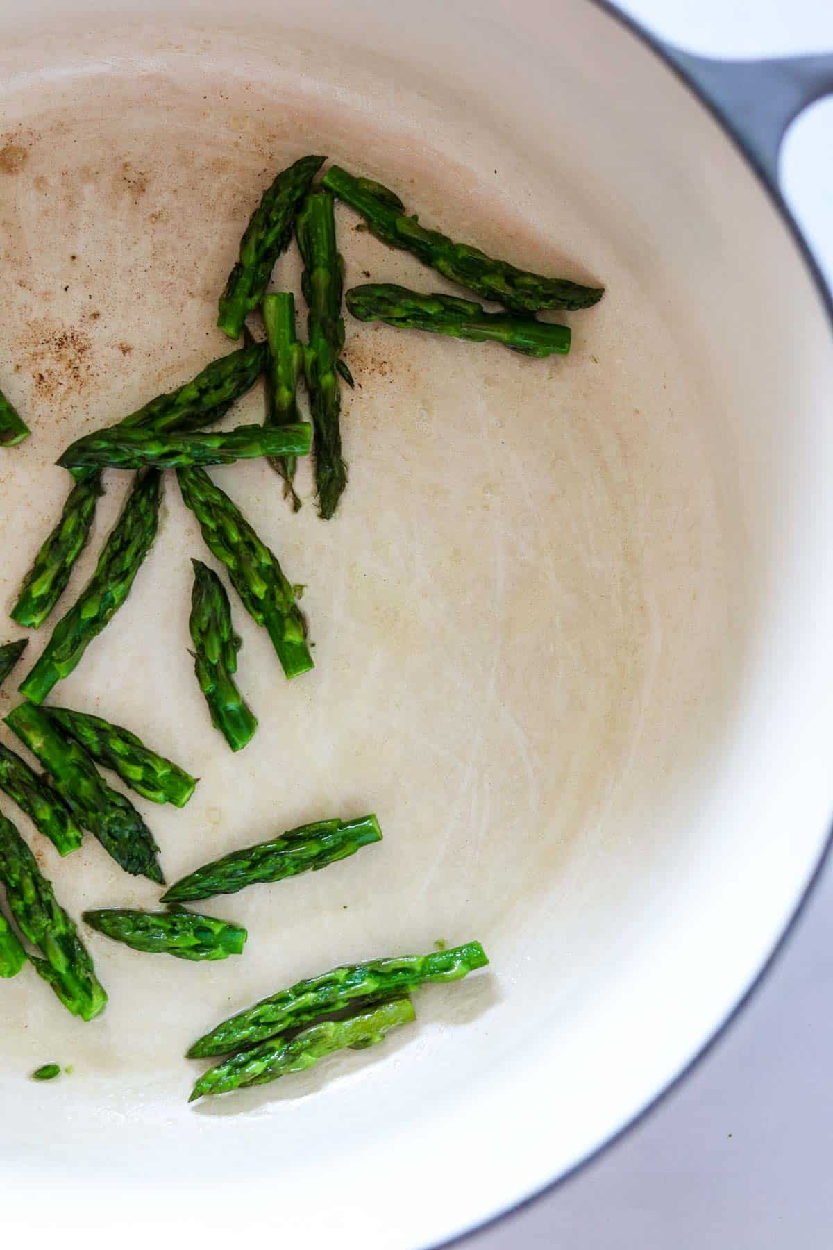 Asparagus tips in a pot.