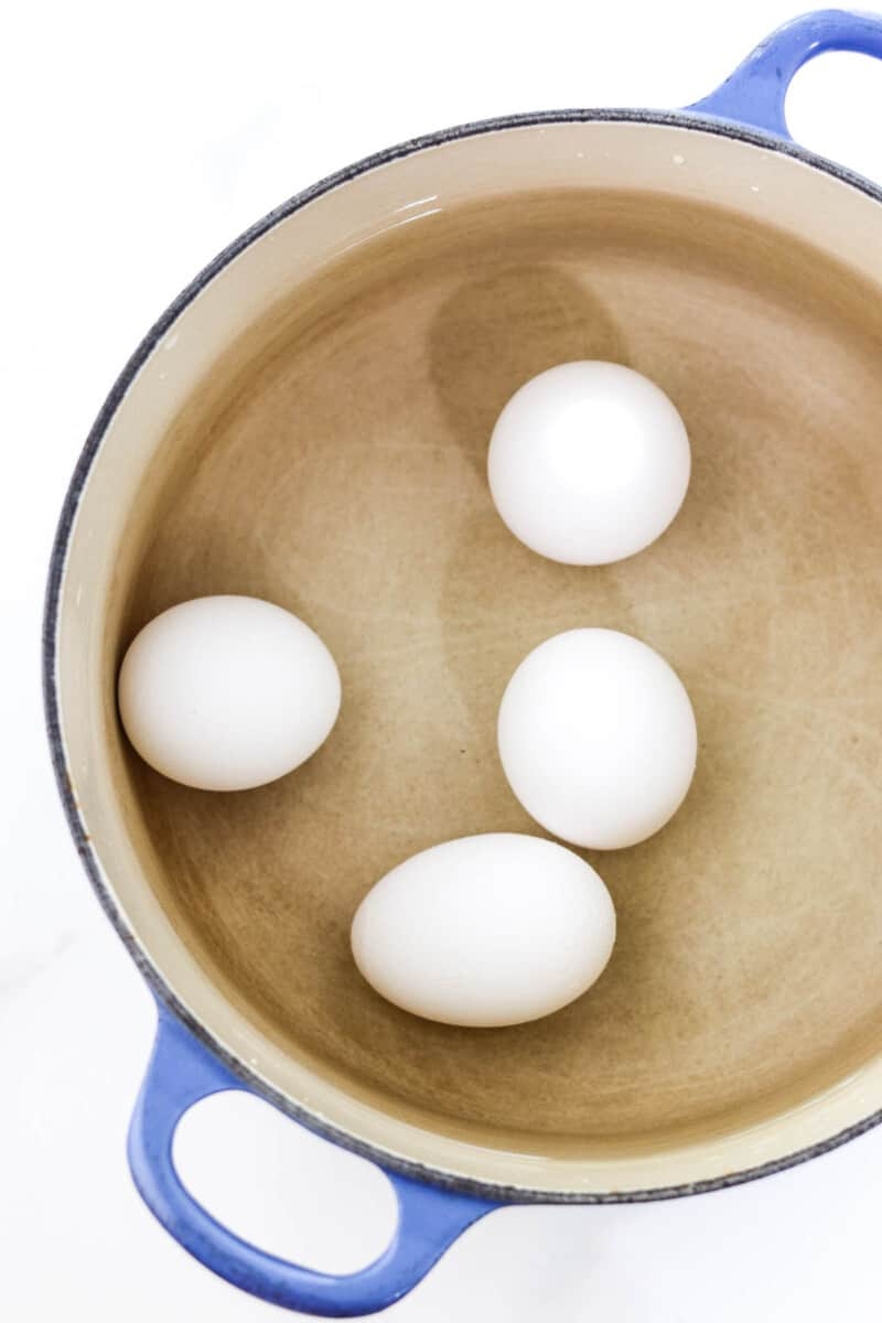 Eggs in a pot of water.
