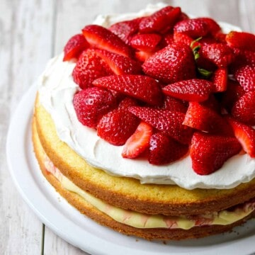Scandinavian Strawberry Cream Cake on a wood surface.