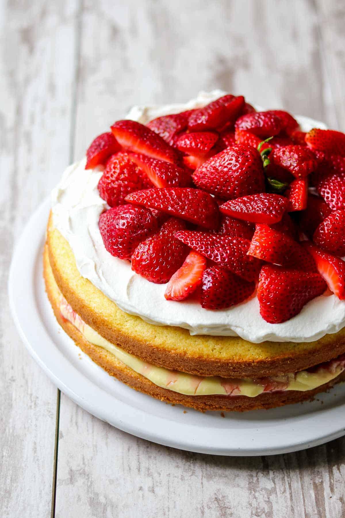 Scandinavian Strawberry Cream Cake on a wood surface.