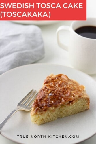 Slice of Swedish Tosca Cake (Toscakaka) on a plate with a fork.