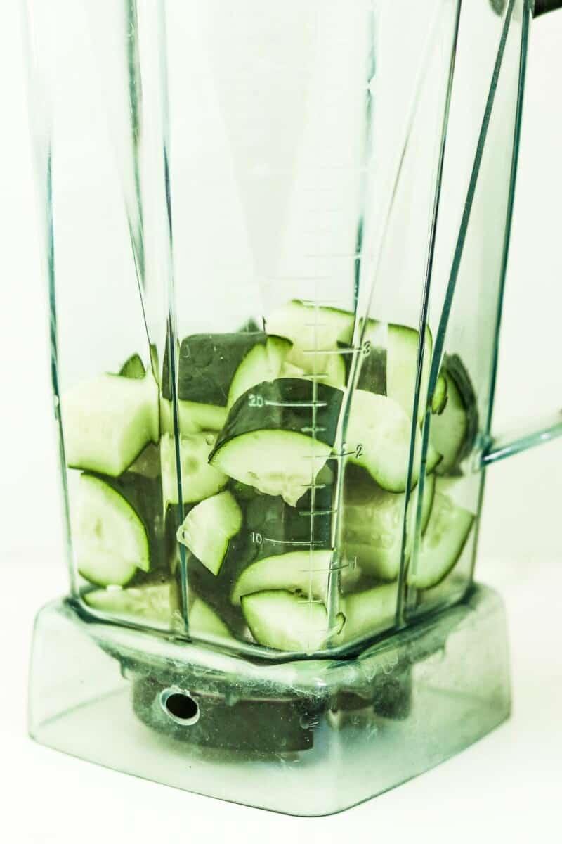 Chopped cucumbers in a blender jar.