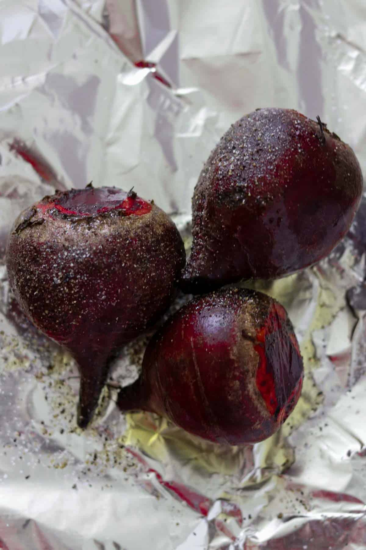 Roasted beets on a piece of foil.