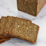 Sliced rye bread on a marble surface.