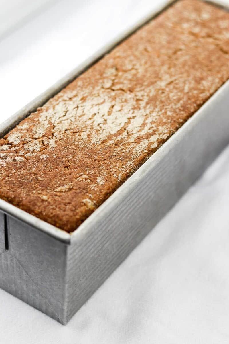 Danish rye bread in a loaf pan.