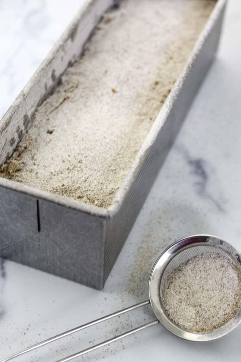 Unbaked Danish rye bread in a loaf pan.
