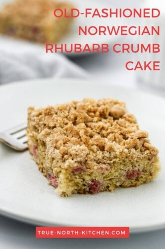 Crumb cake on a plate next to a fork.