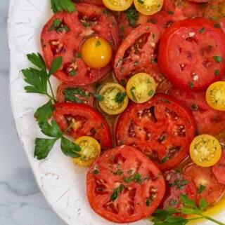 Marinated Garden Tomatoes on a platter.