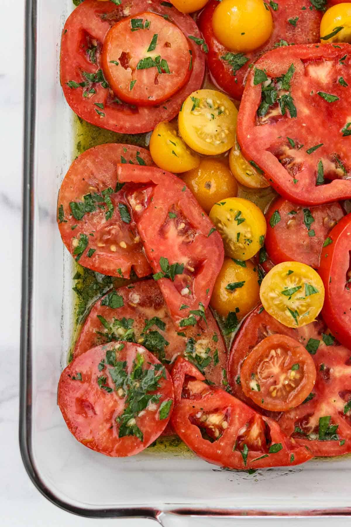 Marinated Garden Tomatoes in a glass dish.