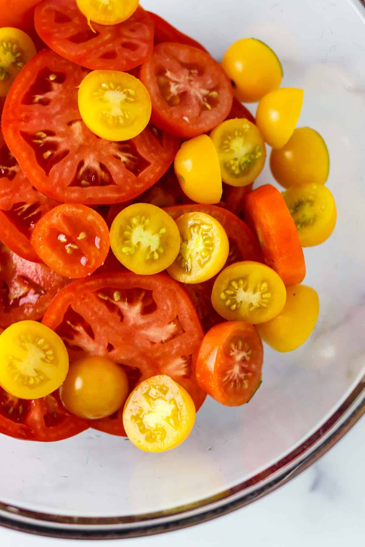 Sliced fresh tomatoes in a glass bowl.