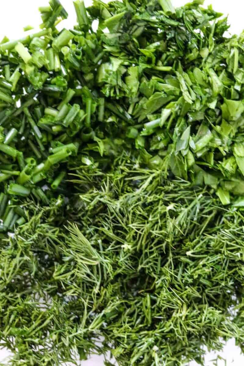 Chopped fresh herbs in a bowl.